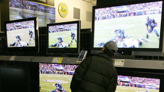 A display of flat-panel televisions at a Best Buy in San Francisco.