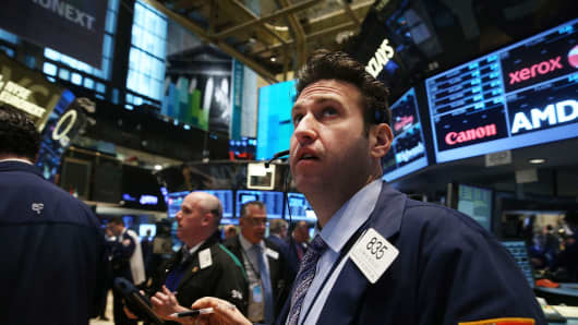 Traders on the floor of the New York Stock Exchange on Monday