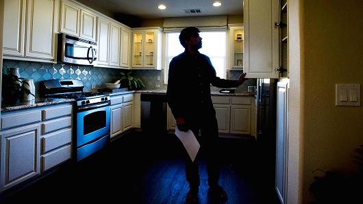 A potential home buyer views a model home at the Shapell Industries Inc. Gale Ranch community in San Ramon, California.