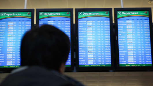 A passenger looks at a departure screen of canceled flights at Atlanta Hartsfield Airport after a snowstorm on Jan. 10.