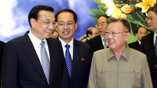 In this Oct. 24, 2011 file photo released by China's Xinhua News Agency, visiting Chinese Premier Li Keqiang, left, meets with late North Korean leader Kim Jong Il, front right, in Pyongyang, North Korea.