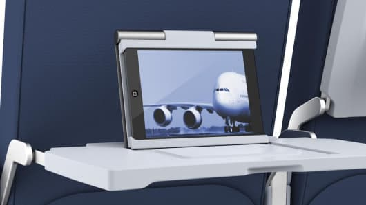 Smart Tray International makes three versions of a tablet-friendly airplane tray table that support travelers' devices or those provided by an airline.