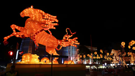 A 10-meter tall horse-shaped lantern adorn the street of Chinatown on January 11, 2014 in Singapore.