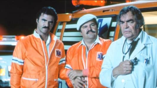 "Burt Reynolds, Dom DeLuise and Jack Elam star in the film, ""Cannonball Run"", where they compete in a cross-country car race."