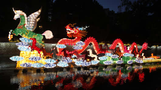 Horse and dragon lanterns are illuminated on Panlong River on January 26, 2014 in Kunming, China.