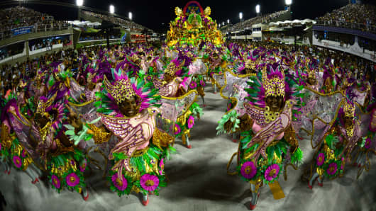 Revelers of Mangueira samba school perform during the second night of Carnival parades at the Sambadrome in Rio de Janeiro on February 11, 2013.