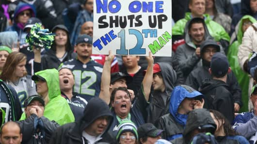 Fans cheer during a game between the Seattle Seahawks and the New England Patriots at CenturyLink Field in Seattle.