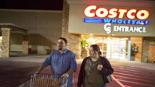 Ben and Erika Trowell walk to their car after buying milk and laundry detergent.