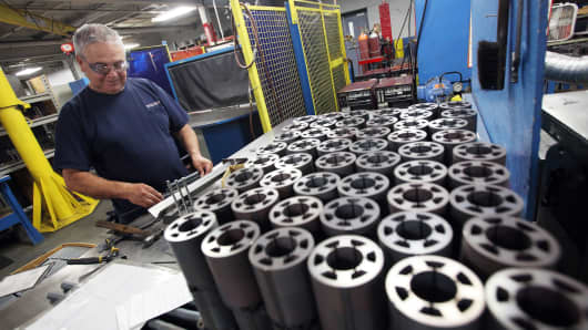 A worker checks pieces of finished product at the Sko-Die Inc. custom metal manufacturing facility in Morton Grove, Illinois.