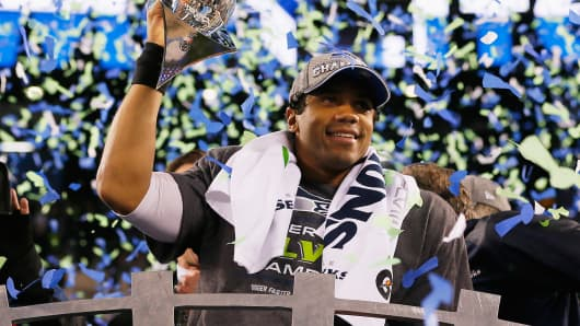 Seattle Seahawks quarterback Russell Wilson with the Vince Lombardi championship trophy at MetLife Stadium