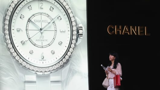 A Chinese woman walks past the Chanel store on June 11, 2012 in Beijing, China.