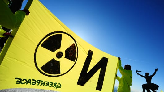 Greenpeace activists protest with their anti-nuclear banner in Budapest.