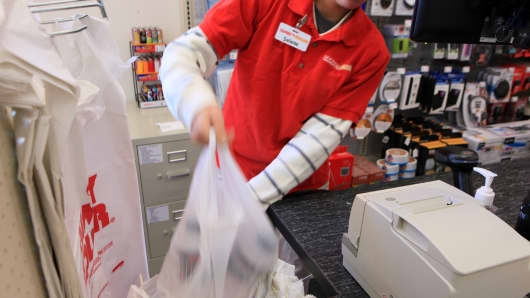 A cashier bags items after scanning them at a Family Dollar Stores Inc. location in Mansfield, Texas.