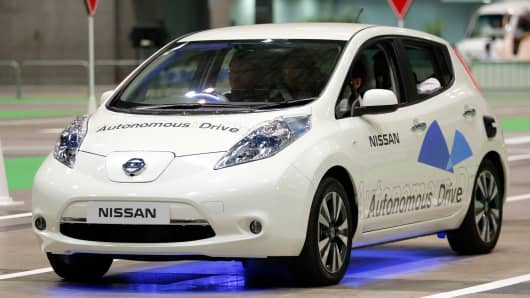 Nissan Motors' Autonomous Drive Leaf electric vehicle is driven for a demonstration ride at the CEATEC Japan 2013 exhibition in Chiba, Japan, on Tuesday, Oct. 1, 2013.