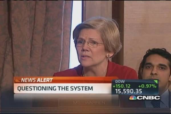 Sen. Warren questions Dimon's pay