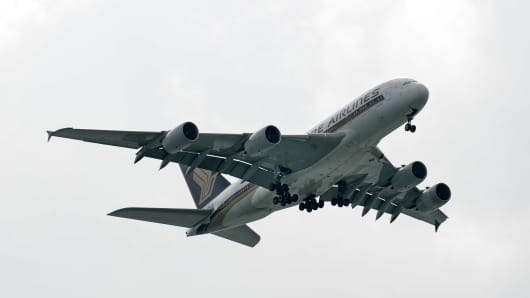 This photograph taken on January 7, 2014 shows a Singapore Airlines Airbus A380 approaching for landing at Changi International Airport in Singapore.