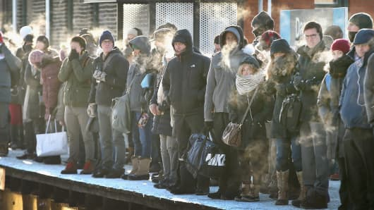 Chicago commuters wait for train in below-zero temperatures on Jan. 7, 2014.