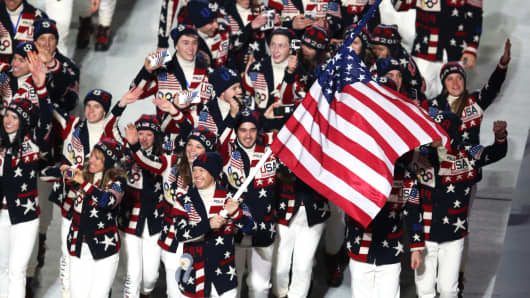 Nordic combined skier Todd Lodwick of the United States Olympic team carries his country's flag during the Opening Ceremony of the Sochi 2014 Winter Olympics at Fisht Olympic Stadium on February 7, 2014.