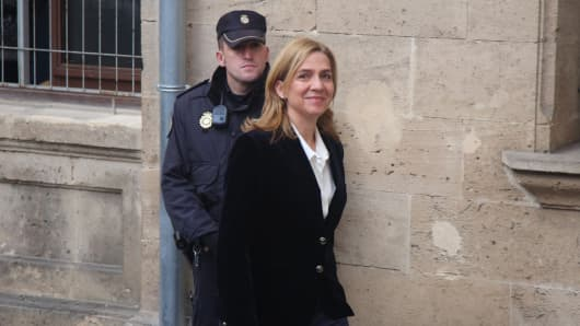 Spain's Princess Cristina arrives at the courthouse to hear the accusations of being a fraud and money laundering in Palma de Mallorca