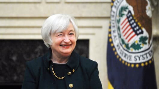 Janet Yellen smiles after taking the oath of office as Chairman of the Board of Governors of the Federal Reserve System February 3, 2014 at the Eccles Building in Washington, DC.