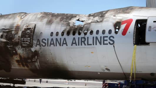 The wrecked fuselage of Asiana Airlines flight 214 sits in a storage area at San Francisco International Airport, July 12, 2013 in San Francisco, California.