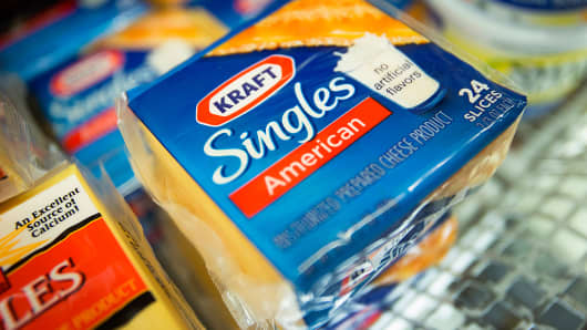 Packages of Kraft Foods' Singles cheese slices are displayed at a supermarket in New York.
