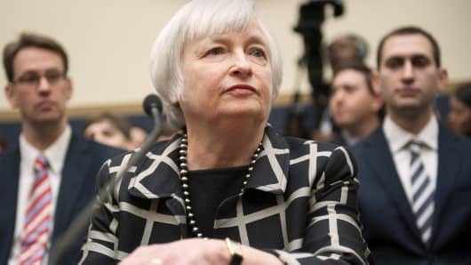 Federal Reserve Chair Janet Yellen listens on Capitol Hill in Washington, Tuesday, Feb. 11, 2014, while testifying before the House Financial Services Committee hearing.