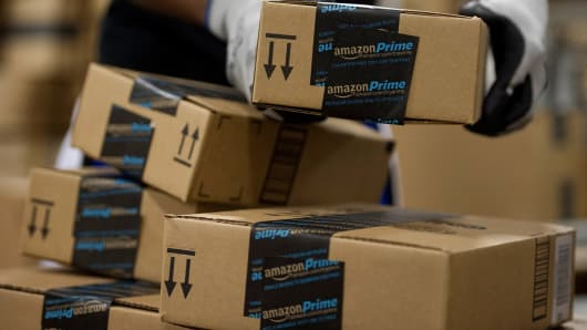 An employee stacks items to be shipped at the Amazon.com Inc. fulfillment center.