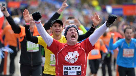 Runners cross the finish line at the 2013 New York City Marathon.