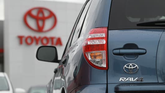 A 2012 Toyota Rav4 at a dealership.