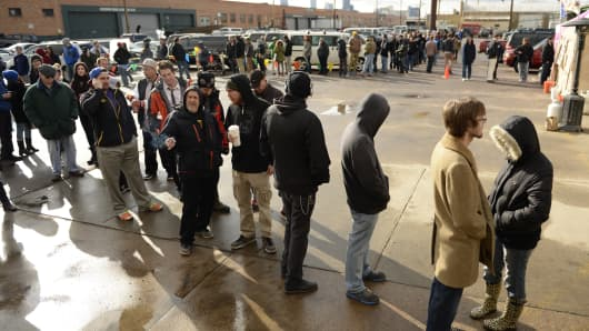 Customers lineup to buy recreational marijuana in Denver, Colorado.