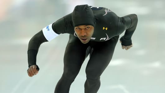 Shani Davis of the United States, wearing an Under Armour uniform, competes during the Sochi 2014 Winter Olympics.