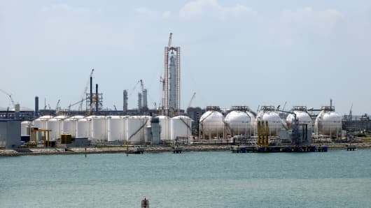 Storage tanks stand on Jurong Island, viewed from Keppel Corp.'s FELS shipyard, in Singapore.