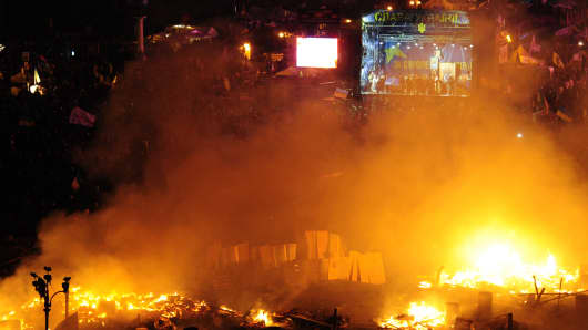 Fires burn in the streets as anti-government protesters clash with police on February 18, 2014 in Kiev, Ukraine.