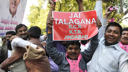 Telangana supporters celebrate after the separate Telangana State bill was passed in Parliament on February 18, 2014 in New Delhi, India.