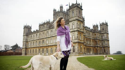 Lady Carnarvon walks her dogs in the grounds of Highclere Castle on March 15, 2011 in Newbury, England. It has recently been made famous as the setting for the hugely popular ITV series Downton Abbey starring Hugh Bonneville, Maggie Smith and Elizabeth McGovern.