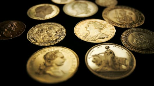 Selection of gold coins at London auction house.