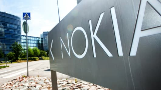 A sign stands outside the headquarters of Nokia Oyj in Espoo, Finland.