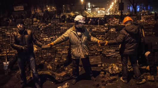 Anti-government protesters stockpile paving stones in an effort to reconstruct and reinforce barricades that were previously stormed by riot police, Kiev, Ukraine.