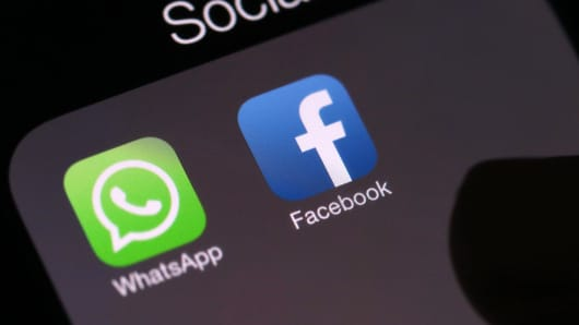WhatsApp and Facebook apps on phone