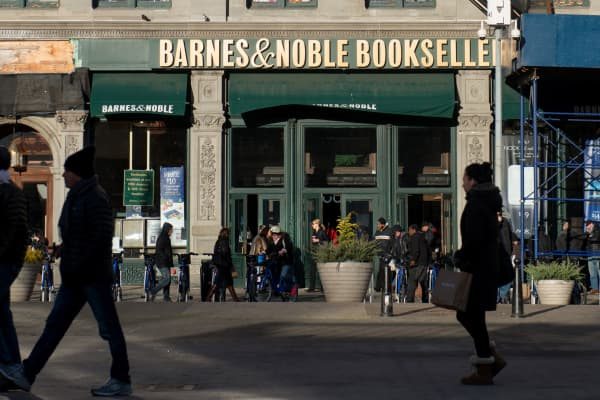 Pedestrians pass in front of a Barnes and Noble Inc. store in New York, Nov. 24, 2013.