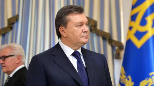 Ukrainian President Viktor Yanukovych looks on before signing an agreement in Kiev on February 21, 2014