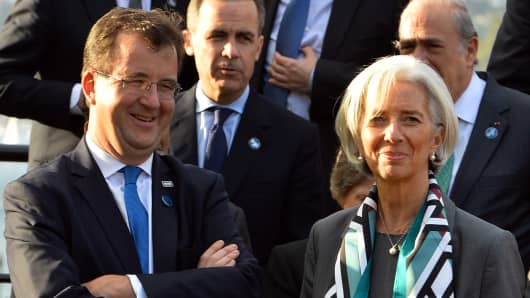 Christine Lagarde (R), International Monetary Fund Managing Director, and World Bank Chief Financial Officer Bertrand Badre.
