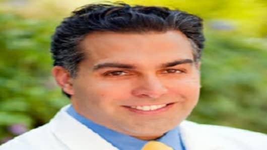 Dr. Amir Choroomi