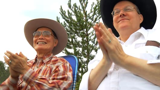 George Takei with husband Brad Takei attending Independence Day parade in Show Low, Arizona, July 4, 2012.