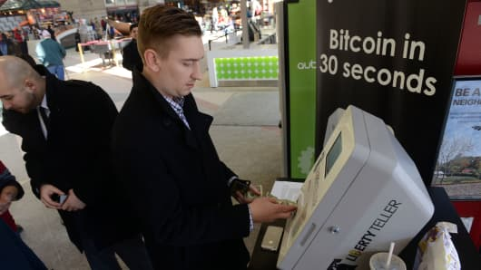 A man purchases some Bitcoin from a newly installed Bitcoin ATM at South Station February 20, 2014 in Boston, Massachusetts.