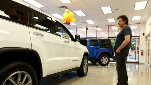 Shopper looks at a Jeep Cherokee diesel at the Hollywood Chrysler Jeep dealership.