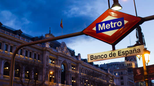 A sign for Banco de Espana stands above the entrance to the metro station outside Spain's central bank, in Madrid, Spain.