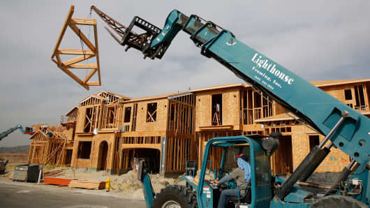 Workers frame new homes at the Toll Brothers Inc. Baker Ranch community development in Lake Forest, California, Feb. 11, 2014.