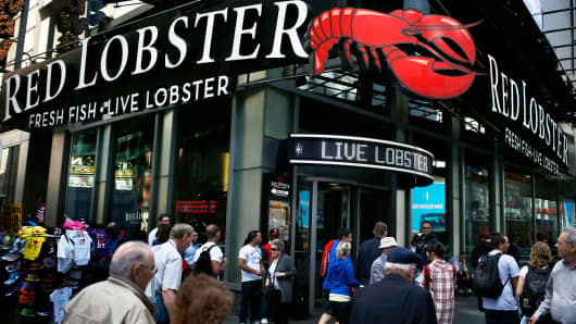 Pedestrians pass in front of a Red Lobster restaurant in New York.